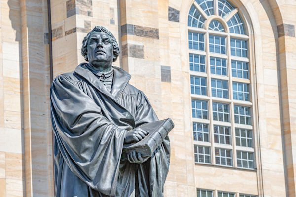 Monument of Martin Luther at  Neumarkt square in downtown of Dresden, a theologist, composer, priest, who has started Reformation in Catholic Church, Germany, details, closeup